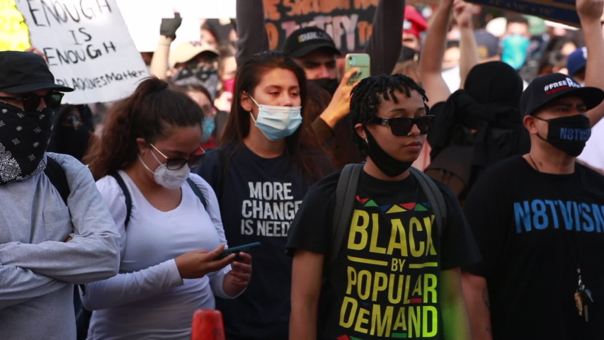 Los Angeles, California / USA - May 29, 2020: People in Downtown Los Angeles protest the brutal Police killing of George Floyd.