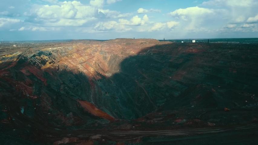 Open pit mining of open pit iron ore.   Shutterstock HD Video #1053660914