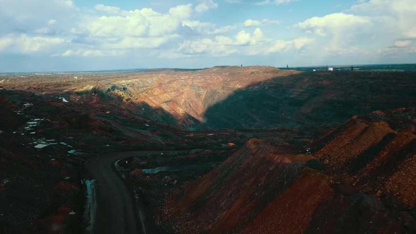 Open pit mining of open pit iron ore.   Shutterstock HD Video #1053660929