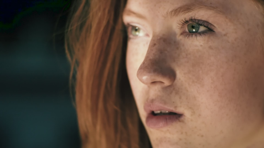 Close up of Woman's Face, Girl opening her Beautiful green Eyes, Attractive Ginger. Natural Beauty with Freckles. Gorgeous woman with long Eyelashes and Attractive Appearance. Slow motion.