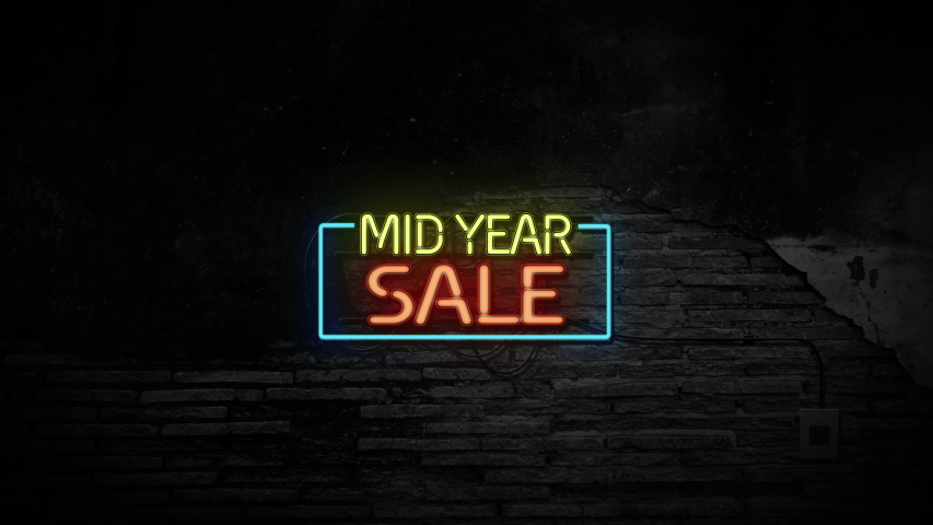 Mid year sale sign neon light on stone brick wall background. Business and service concept. | Shutterstock HD Video #1053680216