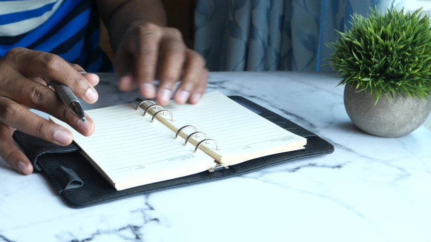 man hand turning a page of a notepad , Top view    Shutterstock HD Video #1053683327
