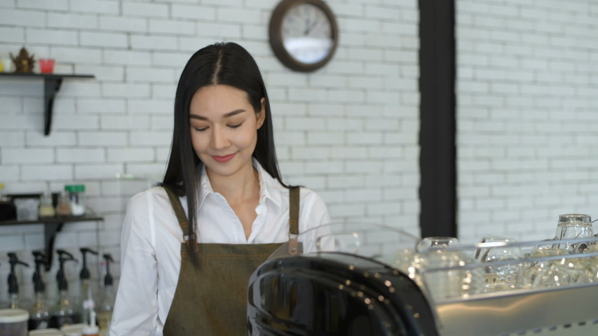 Business concept. The waitress is preparing the equipment before opening the coffee shop. 4k Resolution.   Shutterstock HD Video #1053686288