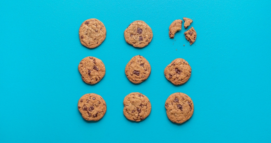 Chocolate chip cookies moving on a blue seamless background. Cookies funny stop motion. Animated chocolate cookies. Home-baked sweet snacks 4k video.  | Shutterstock HD Video #1053690743