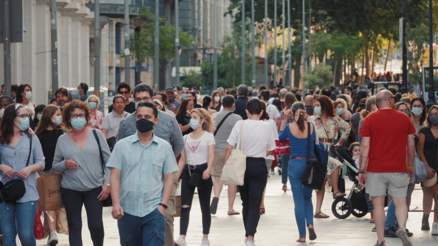 BARCELONA, SPAIN 30 MAY 2020: People crowd in city center after quarantine is over, tourists and citizens in masks, life after covid, first days, pandemic end, reopen of business
