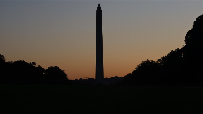 Washington Monument Memorial at twilight at night with Washington DC the sunrise