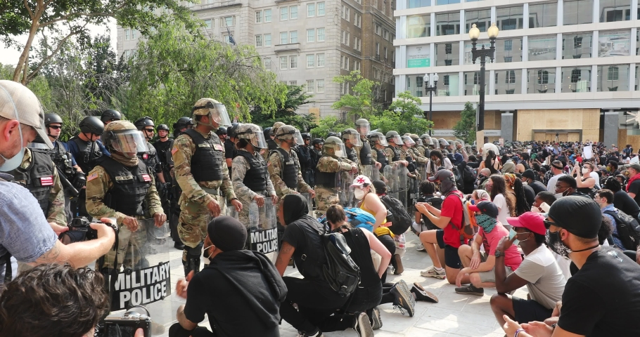 Washington, DC / USA - June 3, 2020: Thousands of people join a Black Lives Matter march near the White House. The National Guard blocks protesters from moving to Lafayette Park.
