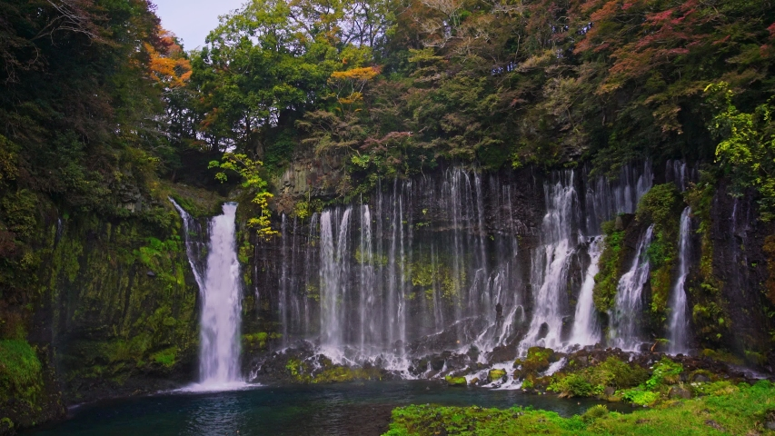 Wide shot of Shiraito waterfall with rainbow in Autumn, Japan   Shutterstock HD Video #1053722906