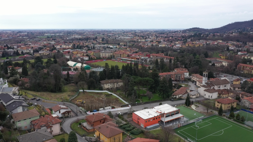 Alzano Lombardo, ZONA ROSSA, Bergamo Val Seriana Italy, paese deserto per epidemia quarantena, Drone Aerial Footage View of Coronavirus red zone quarantine,   // no video editing | Shutterstock HD Video #1053726089