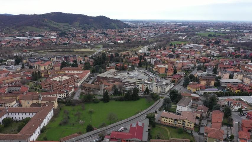 Alzano Lombardo Ospedale, ZONA ROSSA, Bergamo Val Seriana Italy, Ospedale e paese deserto per epidemia quarantena, Drone Aerial Footage View of Hospital Coronavirus red zone quarantine,   // no video  | Shutterstock HD Video #1053726458
