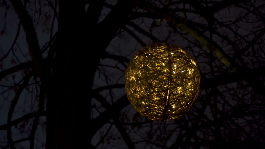 Hanging ball of lights in the tree in Tallinn Estonia found in the park at a night time | Shutterstock HD Video #1053726626