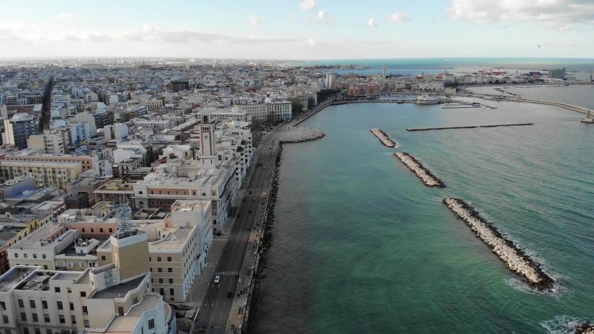 Drone flight over the sea along the coastline over the Bari, Puglia, Italy. Aerial view in 4K