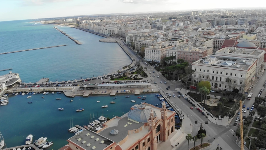 Aerial shot of a beautiful italian city by the sea. Drone flight over old town of Bari, Puglia, Italy. 4K