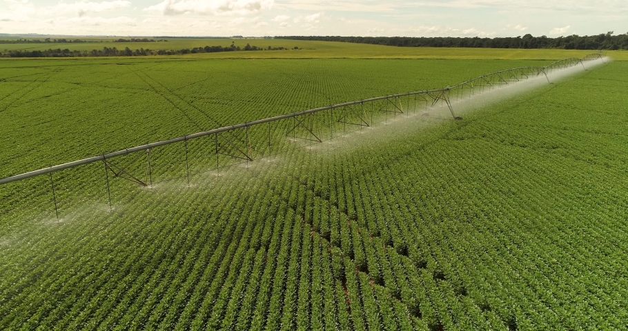 Agribusiness - Pivot irrigation used to water plants on a farm. Smooth movement, circular pivot irrigation with drone - agriculture Royalty-Free Stock Footage #1053746678