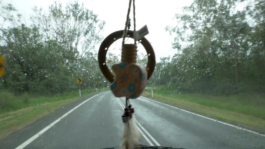 Dreamcatcher in Van driving on a rainy day in Queensland Australia. Vanlife Dreamcatcher Campervan Cape Tribulation Sea Side Road Driving in the rain. Car Freshner. Screen wiper blades | Shutterstock HD Video #1053747044
