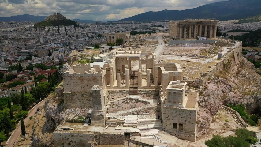 Aerial drone video of Acropolis main entrance gateway as seen on a beautiful cloudy spring morning, Athens, Attica, Greece Royalty-Free Stock Footage #1053748886