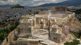 Aerial drone video of Acropolis main entrance gateway as seen on a beautiful cloudy spring morning, Athens, Attica, Greece
