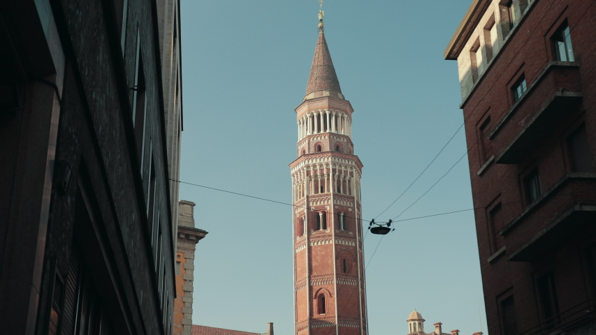 San Gottardo In Corte Or San Gottardo Palazzo Is A Church Milan, Northern Italy, Lombardy. Street Leads To High Bell Tower Of The Temple. Bright Sunny Day | Shutterstock HD Video #1053749519