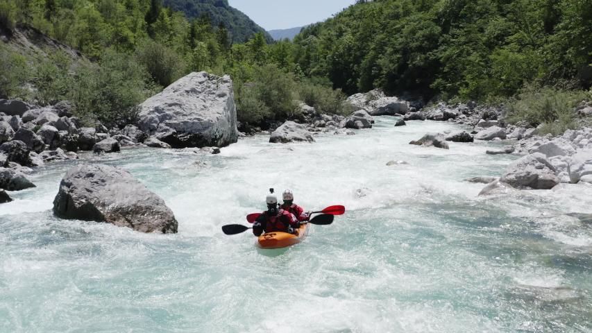 Aerial follow cam shot of dual kayak going down the emerald alpine river Soca, Slovenia | Shutterstock HD Video #1053752468