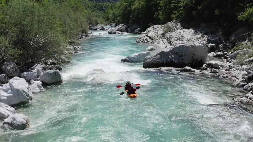 Aerial follow cam shot of dual kayak going down the emerald alpine river Soca, Slovenia | Shutterstock HD Video #1053752492