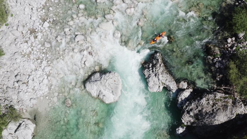 Aerial shot top down shot kayaking a big rapid on emerald alpine river Soca, Slovenia | Shutterstock HD Video #1053752498