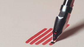 Close up of dip pen drawing thick lines by red ink. 4K resolution macro shot. High quality audio recorded with condenser microphone.