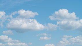 Blue sky white clouds. Puffy fluffy white clouds. Cumulus cloud cloudscape timelapse. Summer blue sky time lapse. Nature weather blue sky. White clouds background. Cloud time lapse nature background.