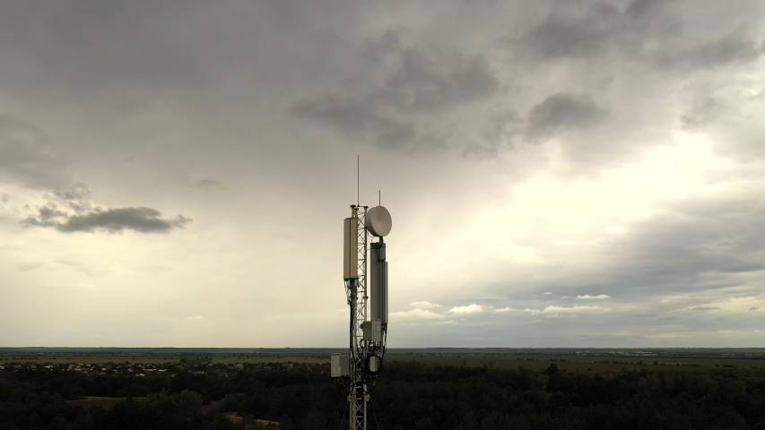 Aerial view of cell tower antennas for wireless 3G, 4G or 5G mobile phone networks and telecom internet communication | Shutterstock HD Video #1053765497