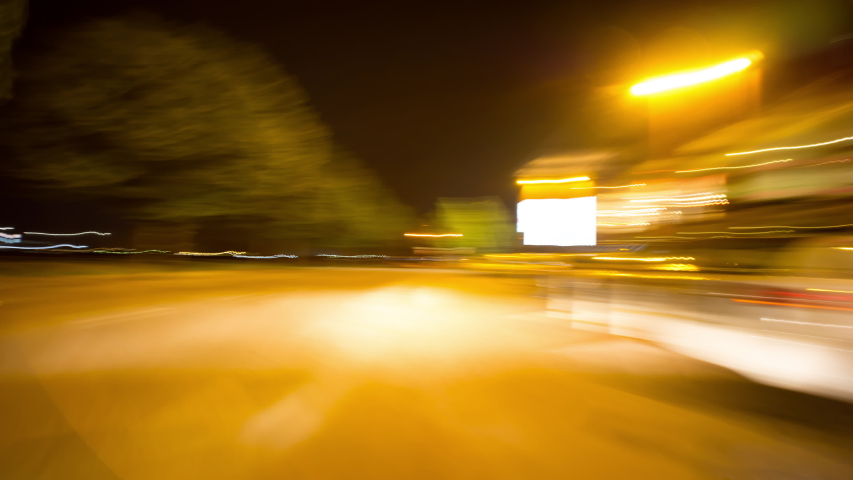 This video features a non-stop point of view shot of a beautiful city street at night. It was taken from a fast moving vehicle.  | Shutterstock HD Video #1053773834