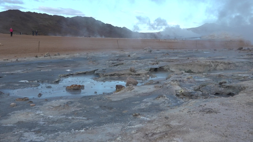 Iceland. Geothermal field with fumaroles and geysers. Area with natural steam vents and mud pools all around Lake Myvatn, the Hverir geothermal fields.