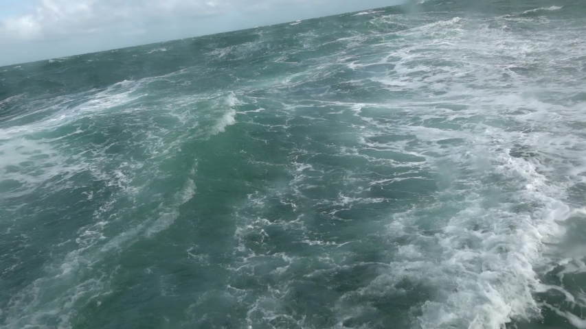 Big storm waves in the ocean. View from the stern of the sailboat. | Shutterstock HD Video #1053786266