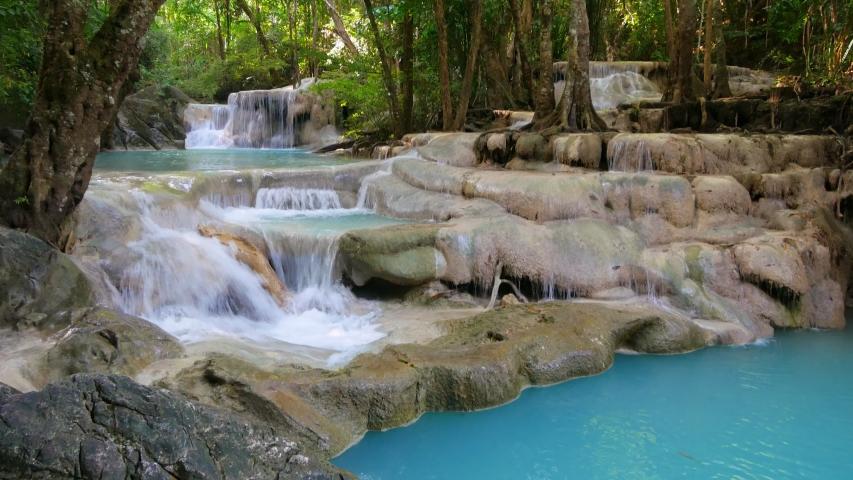 Erawan waterfall in the forest of Kanchanaburi, Thailand (dolly shot)   Shutterstock HD Video #1053795698