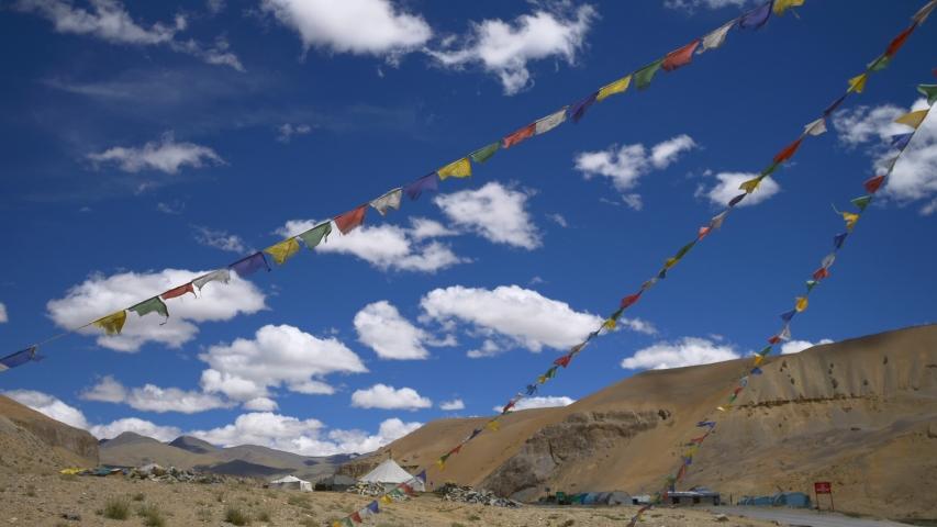 Prayer flags waving in the wind at the Leh city, Leh Ladakh, India   Shutterstock HD Video #1053795701