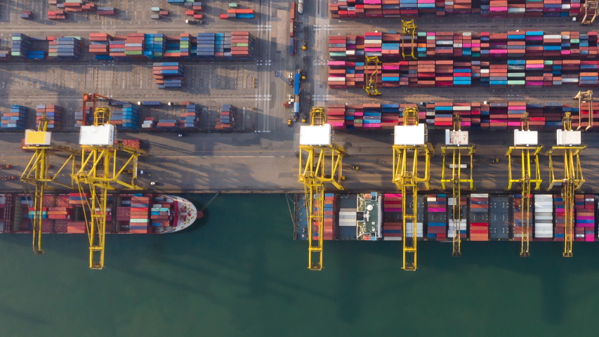 Time lapse container , Container ship in export and import business and logistics. Shipping cargo to harbor by crane. Water transport International. Aerial view and top view | Shutterstock HD Video #1053798458