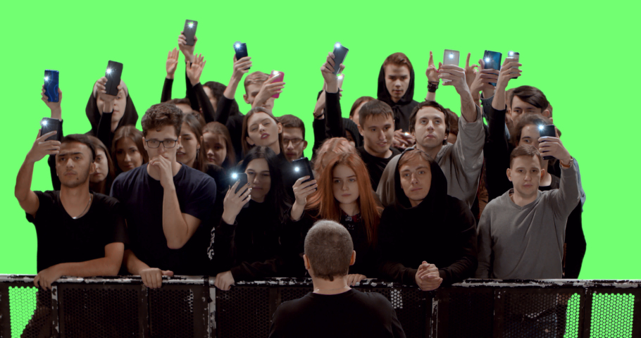 GREEN SCREEN Front view huge crowd of people with phones in hands at live concert or show. Shot on RED Helium 8K, Prores 4444 | Shutterstock HD Video #1053824960