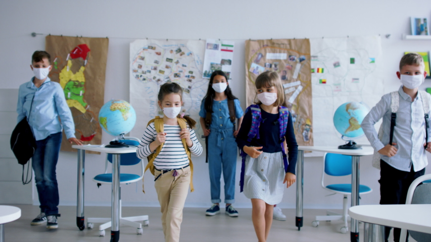 Group of children with face mask back at school after covid-19 quarantine and lockdown. Royalty-Free Stock Footage #1053843215