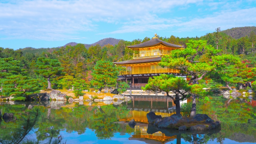 Kinkaku-ji literally Temple of the Golden Pavilion, officially Rokuon-ji or Deer Garden Temple, is a Zen Buddhist temple and part of Historic Monuments of Kyoto, UNESCO World Heritage. Kyoto, Japan. | Shutterstock HD Video #1053848216