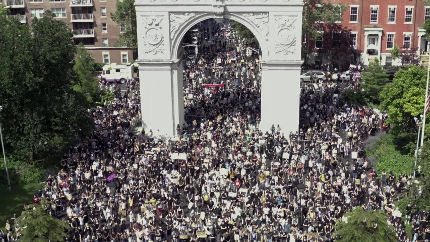 NEW YORK - JUNE 6, 2020: Washington Square Park filled to capacity with protestors activists Black Lives Matter allies with signs protesting the police killing of George Floyd, demonstration in NYC.