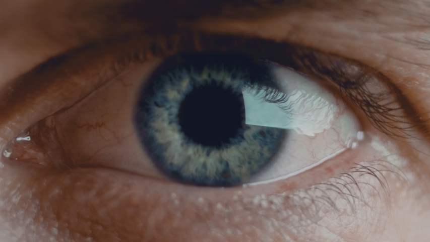 Close up shot of eye opening with beautiful blue iris. Healthy eyesight concept. Front view macro video in 4K. | Shutterstock HD Video #1053877946