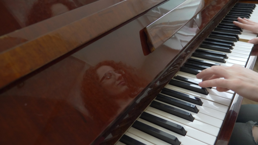 closeup. female hands masterfully play the arpeggio on the piano.