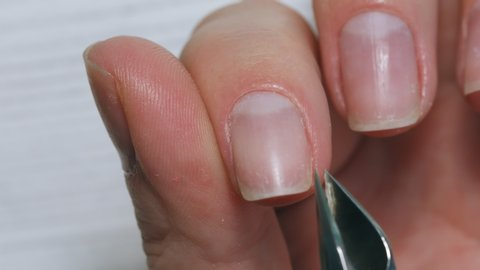 Manicurist makes himself a manicure with professional tools for manicure. Manicure Nails service.