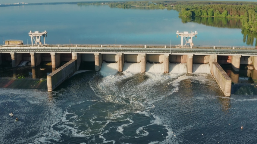 Dam with flowing water on river, aerial view. Hydroelectric power station, hydro energy Royalty-Free Stock Footage #1053899708