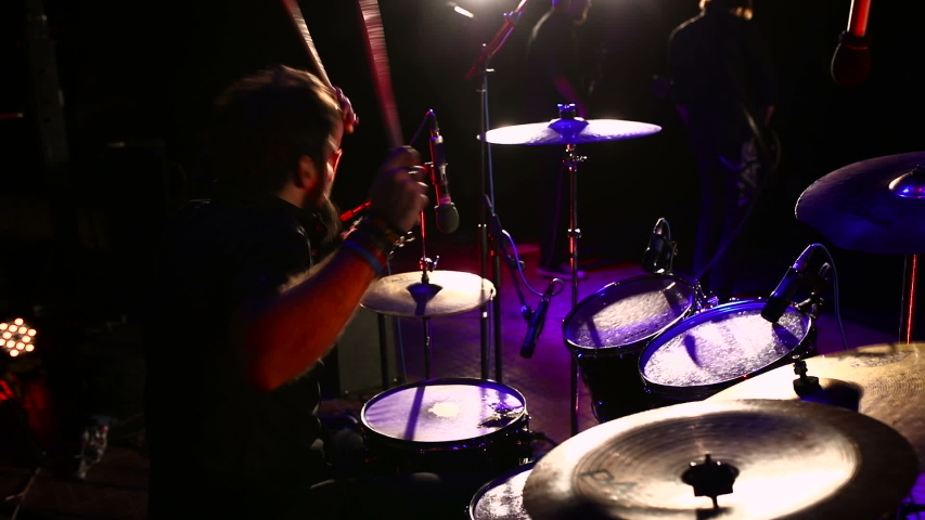 Drummer playing on drums on music concert.