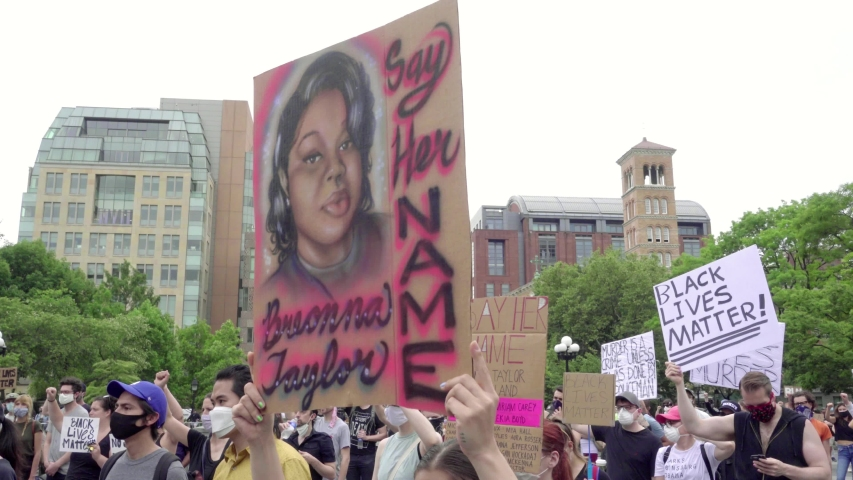 NEW YORK - JUNE 5, 2020: Breonna Taylor tribute - say her name sign at Black Lives Matter rally in Washington Square Park, New York City, NYC.