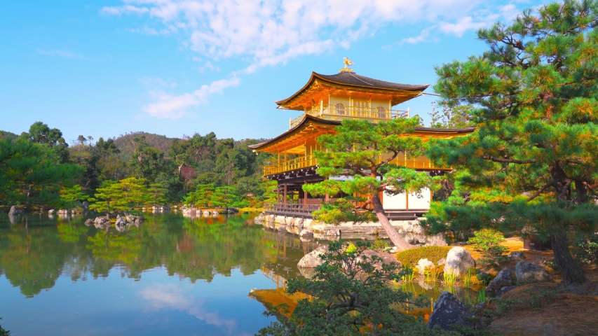 Kinkaku-ji literally Temple of the Golden Pavilion, officially Rokuon-ji or Deer Garden Temple, is a Zen Buddhist temple and part of Historic Monuments of Kyoto, UNESCO World Heritage. Kyoto, Japan. | Shutterstock HD Video #1053912308