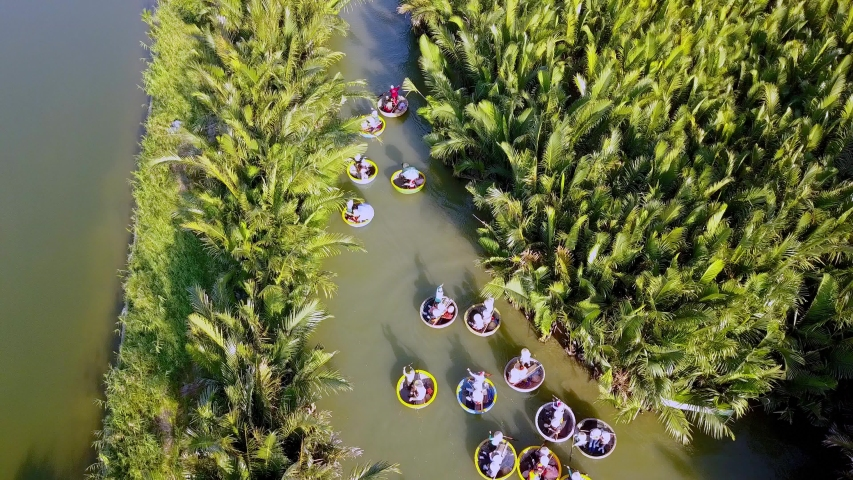 Coconut village eco tour in Hoi An Vietnam with Bamboo basket boats on Thu Bon River, Aerial pan up shot