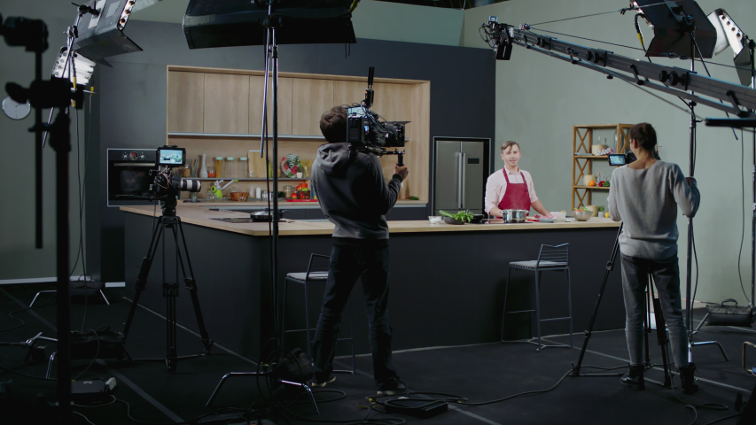 WIDE Behind the scenes of studio set, shooting TV television cooking show featuring celebrity chef, professional TV production. Shot on ARRI Alexa Mini | Shutterstock HD Video #1053918326