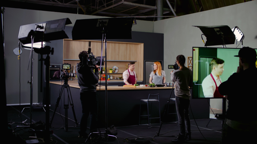 WIDE Behind the scenes of studio set, shooting TV television cooking show featuring celebrity chef, professional TV production. Shot on ARRI Alexa Mini Royalty-Free Stock Footage #1053918329