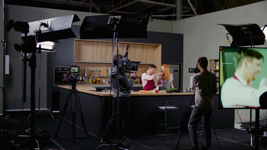 WIDE Behind the scenes of studio set, shooting TV television cooking show featuring celebrity chef, professional TV production. Shot on ARRI Alexa Mini Royalty-Free Stock Footage #1053918332