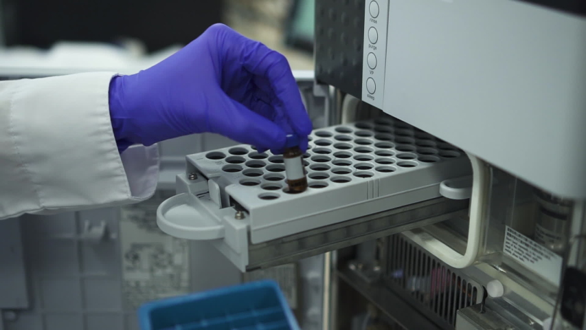 Modern biochemical analyzer filled with test tubes. spbd Genetics worker putting inserting test tubes bottles with dna into the pcr thermal cycler or amplifier for diagnostics. concept pharmaceutical Royalty-Free Stock Footage #1053920756
